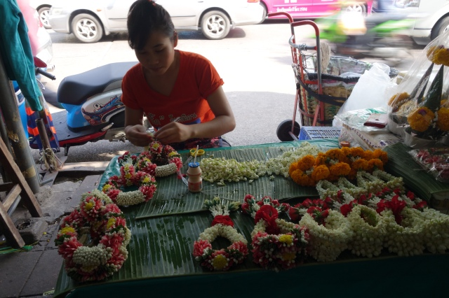 Amazingly fast at stringing the flowers