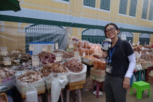 Pia, our guide, in front of a variety of dried fish