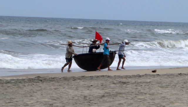 One man could lauch boat, but took four to bring back up on the sand.