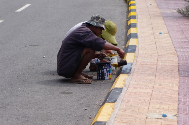 Painting the curbs for festival in a couple of days
