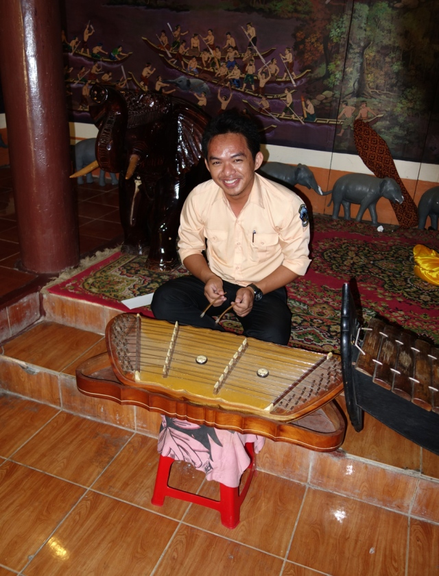 Our guide playing traditional instrument