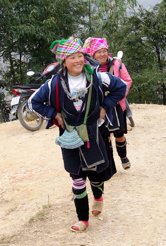 These lovely Muong women follow trekkers for a while and then want us to buy something from them