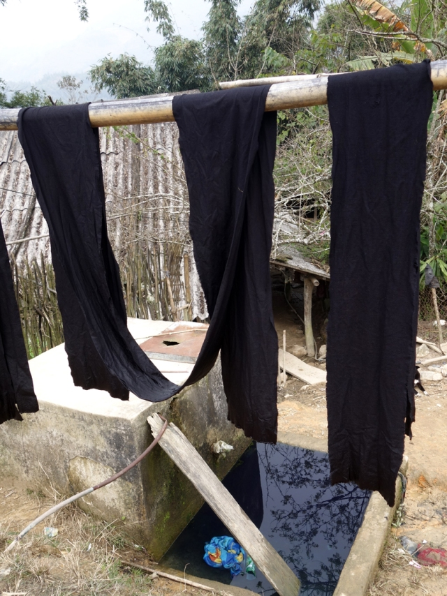 Black Thai cloth dyed with indigo drying in the sun
