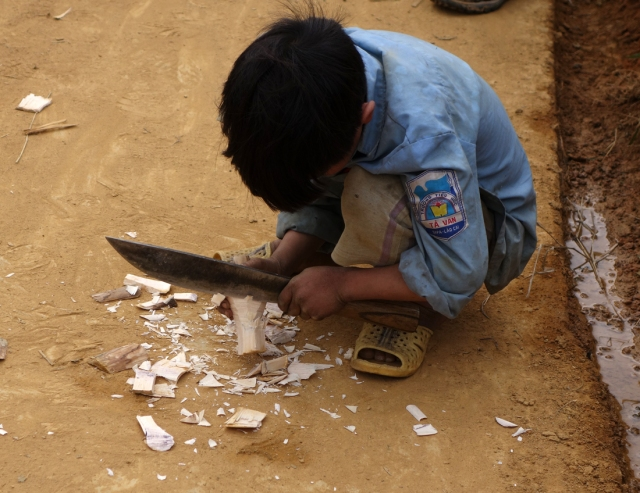 Making a toy -- they use large knives at very young ages