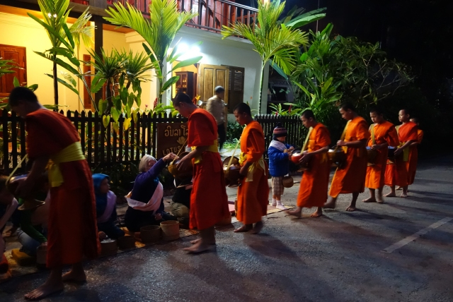 Monks receiving the alms