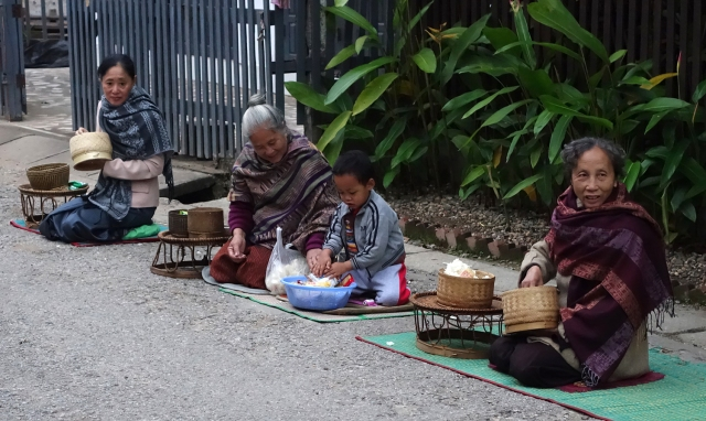 Local devoted Buddhists waiting for Monks