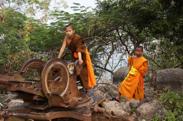 Novice monks playing on artillery on top of Mt.
