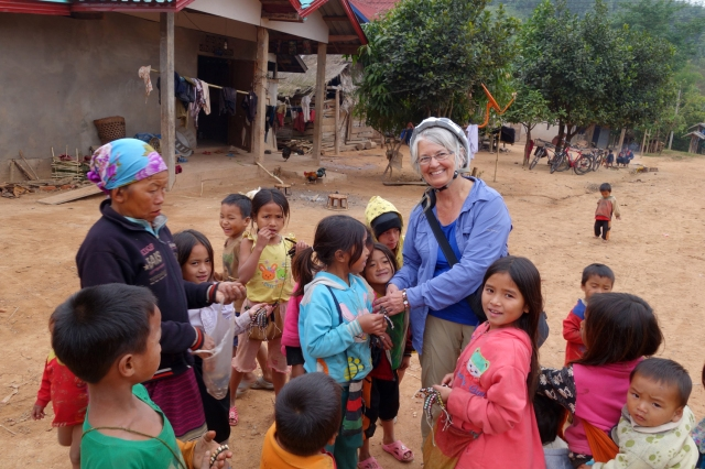 Mobbed by children selling brackets in the Ahka village